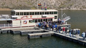 Passengers loading onto Dolly Steamboat on Canyon Lake in AZ