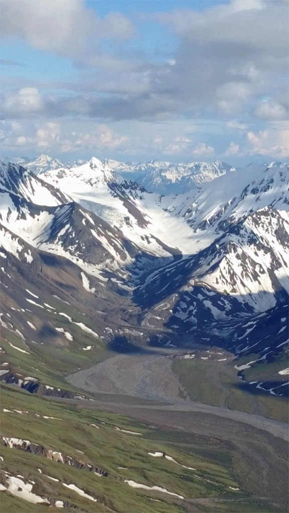 Approaching the snow-capped Alaska Range