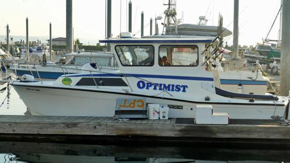 Captain Daniels boat Optimist at dock
