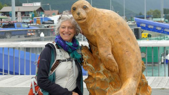 Wendy poses with carved seal sculpture