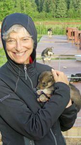 Wendy cuddles a future champion sled dog