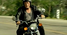 "Taiwan's TC Bank television commercial ""Dream Rangers"": An old Taiwanese man wearing a leather jacket riding a motorcycle in Taiwan."