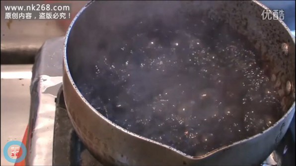 """The water and """"tar"""" mixture being boiled."""