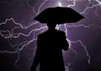 man holding an umbrella in lightening storm
