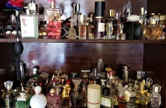 photo by alison blackman two shelves of fragrances, perfumes