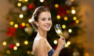 woman with champagne glass glam shutterstock_1197910885.jpg holiday glam By Syda Productions