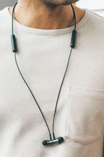 1 more headphones showing magentic closure like a necklace