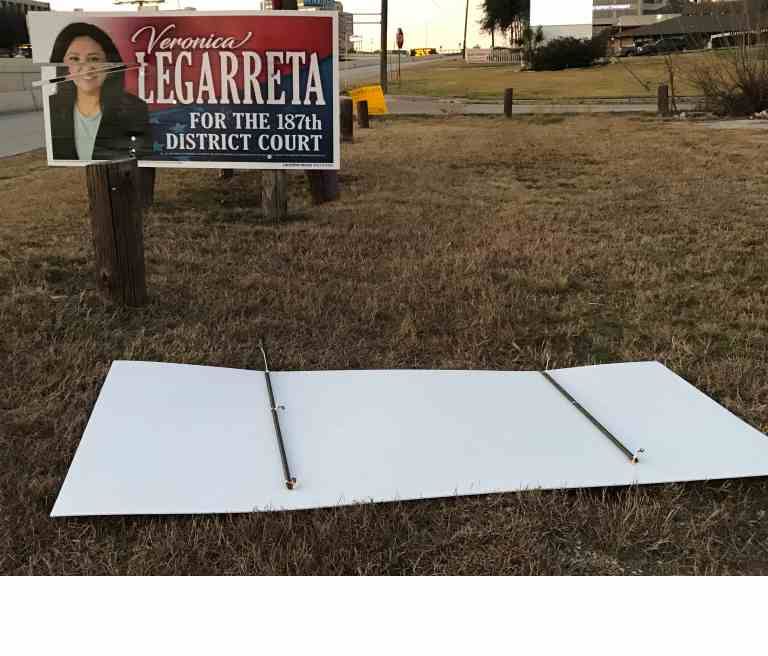Vandalized political signs