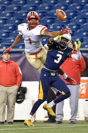 Isaiah Likely of Everett breaks up this pass intended for Brian Abraham of Xaverian during their 35-10 MIAA Div. 1 Super Bowl win at Gillette Stadium, Saturday, Dec. 2, 2017.