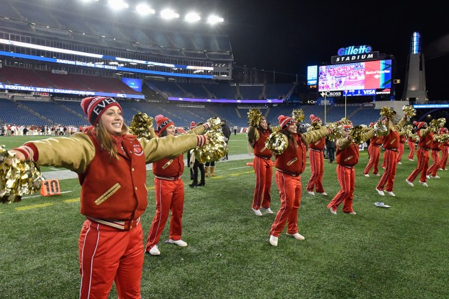 Members of the Everett High School cheerleading team pump up the crowd along the sidelines during Everett's 35-10 MIAA Div. 1 Super Bowl win over Xaverian at Gillette Stadium, Saturday, Dec. 2, 2017.