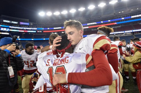 Everett players Shaddai Irung and Jake Wilcox embrace after their 35-10 MIAA Div. 1 Super Bowl win over Xaverian at Gillette Stadium, Saturday, Dec. 2, 2017.