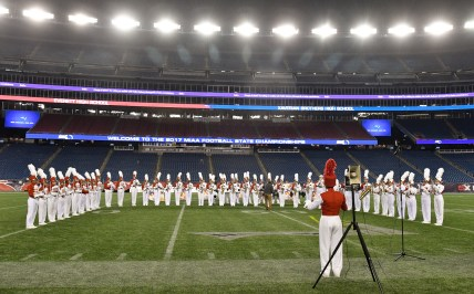 Members of the Everett High School marching band perform their half-time show during Everett's 35-10 MIAA Div. 1 Super Bowl win over Xaverian at Gillette Stadium, Saturday, Dec. 2, 2017.