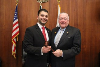 """Anthony DiPierro named City Council president --- Councillor-at-Large John Hanlon (right) passes the council president's gavel to Ward 3 Councillor Anthony DiPierro. See more 2017 photo highlights on pages 12 & 13. -- Councillor-at-Large John Hanlon, a 50-plus-year civil servant in Everett, passed the council president's gavel to the City Council's youngest member, Ward 3 Councillor Anthony DiPierro, at the council's first meeting of the year in January. """"It's an honor and a privilege to serve the people of Everett with you, and I'm humbled by the faith and trust you've put in me by in my first term electing me president of this body,"""" said DiPierro after taking his seat at the head of the council. He added, """"This is going to be a great year for Everett."""