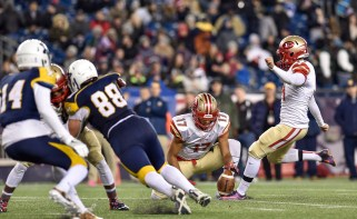 David Zorrilla holds the ball for Caio Costa of Everett on an extra point attempt during their 35-10 MIAA Div. 1 Super Bowl win over Xaverian at Gillette Stadium, Saturday, Dec. 2, 2017.
