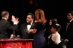 Mayor Carlo DeMaria is sworn-in to another term as mayor by City Clerk Sergio Cornelio while his wife, Stacy, and their children, Alexandra, Caroline, and Carlo III look on.