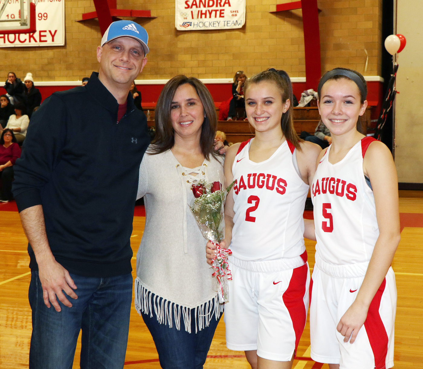 Captain Rachel Nazzaro with her parents, Melissa and Mark and sister/teammate #5 Jessica.
