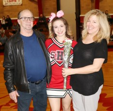 Captain Julia Dreyer with her parents, Cathy and Andy.