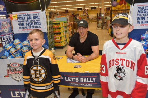 Matthew Psaros, Brad Marchand, and Christopher Psaros
