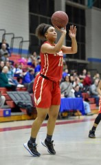 Kiana Wilkerson of Everett takes a shot on net during their game against Somerville at Somerville High School on Tuesday, Feb. 13, 2018.