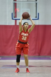 Yasmeen Guerrier of Everett looks to set up a play during their game against Somerville at Somerville High School on Tuesday, Feb. 13, 2018.