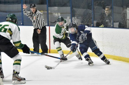 Jaret Simpson of Lynnfield moves the puck during their game against Pentucket-Georgetown at the McVann-O'Keefe Rink in Peabody on Tuesday, Feb. 20, 2018.