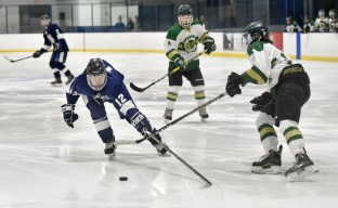 Joey Mack of Lynnfield reaches for a loose puck during their game against Pentucket-Georgetown at the McVann-O'Keefe Rink in Peabody on Tuesday, Feb. 20, 2018.