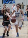 Peabody's Georgia Leon chases after a loose ball against Beverly's Kylie McCarthy in last Friday's game at the PHS Gym. (Advocate photos by Greg Phipps)