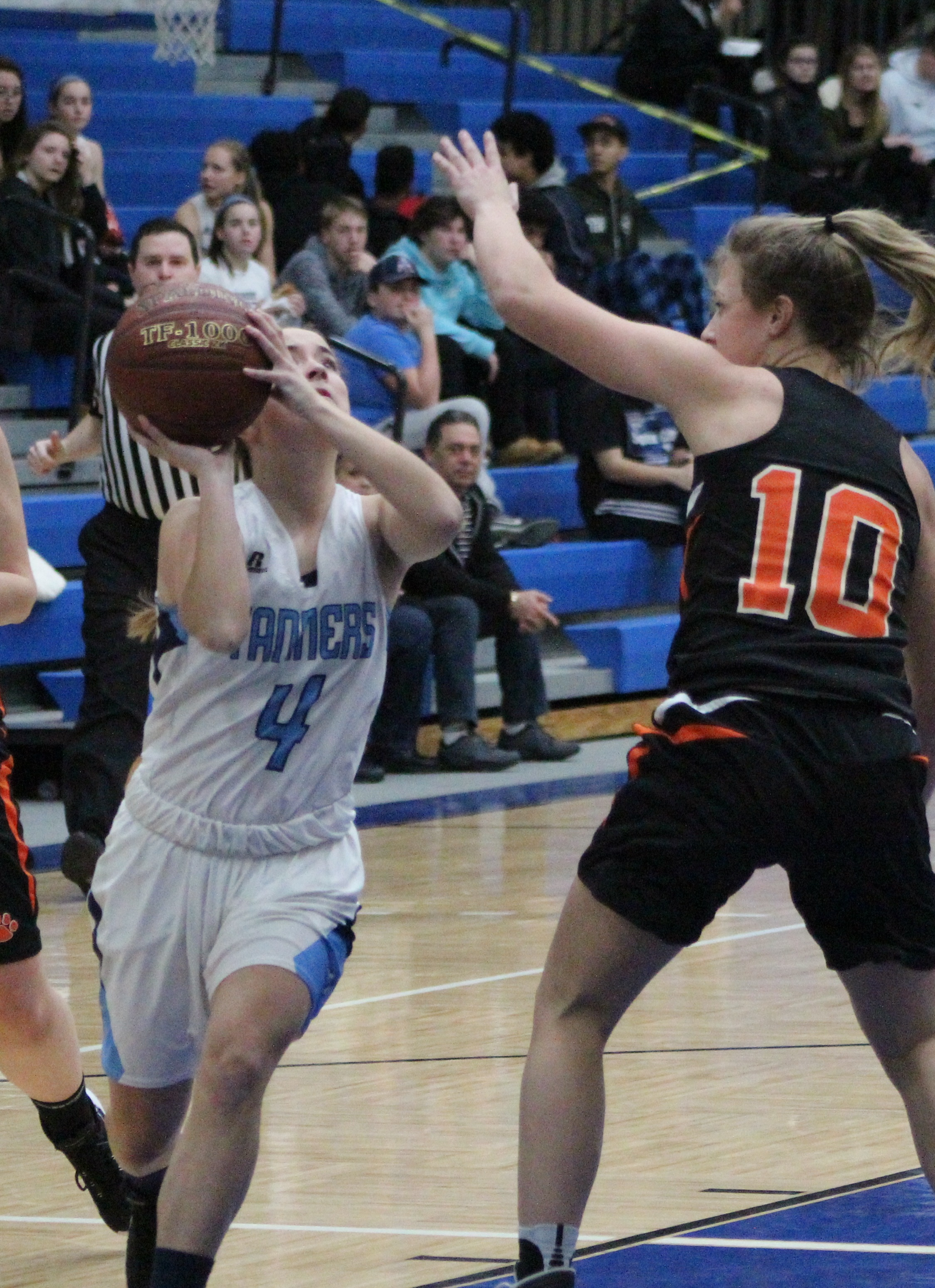 Peabody guard Emily Carney takes it to the basket against Beverly's Lia Whitehair