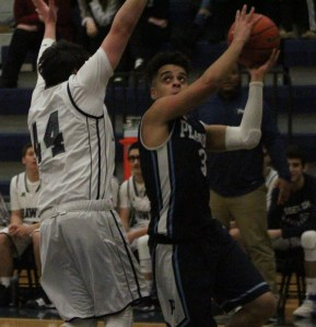 Tanner guard Jonell Espinal goes strong to the hoop on Monday.