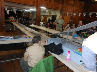 MONITORING THE ACTION: Jake D'Eon looked over the track before the start of last Saturday's Pinewood Derby, which was held in the basement of Cliftondale Congregational Church.
