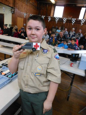"""A ROUGH RACING DAY: Jake D'Eon, 11, had one of the fastest cars in his two previous Pinewood Derbies with Saugus Cub Scout Pack 62, finishing in second place twice. But his entry """"Mash"""" – in his final derby as a Cub Scout, looked great, but """"didn't run so good,"""" he said."""