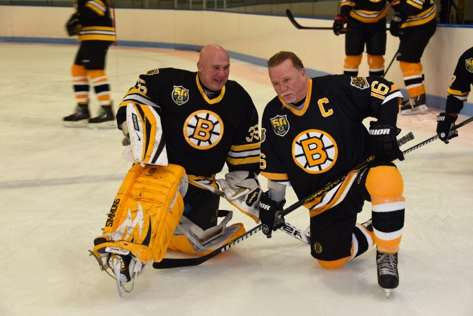 Cleon Daskalakis with Bruins Captain Rick Middleton