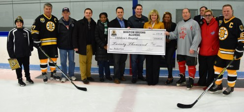 The Boston Bruins Alumni Team and Boston Strong All-Star present a sponsorship donation dheck for $20,000 to Children's Hospital after their All Star Game on Sunday, March 11. Shown at the event, from left to right, are are Patrick Keefe III, Bruins Captain Ray Bourque, Ward 2 Councillor Ira Novoselsky, State Senator Joseph Boncore, Boston City Councilor District 1 Lydia Edward, Ward 4 Councillor Patrick M. Keefe, Jr., Councillor-at-Large Steven Morabito, Republican candidate for U.S. Senate Beth Lindstrom, Nesdco Executive Asst. Staycy Fetching, Boston Strong All-Star Captain Kevin Chiles, Game Coordinator Jim Dwyer, and Bruins Captain Rick Middleton.