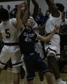 Peabody's Mike Tansey gets hit hard while going up for a rebound in last week's playoff loss.