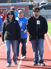 Linda and Zackary Capoccia head in to the completion of the 1st lap around Della Russo Stadium of the 6.5 mile walk for Martin Richard.