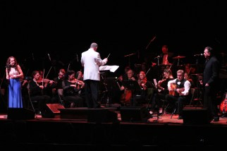 """Freda World Music, backed by a 25-piece orchestra and rhythm section, perform """"The Dream"""" last Saturday night, April 7, at the Lynn Auditorium. (Advocate photos by Greg Phipps)"""