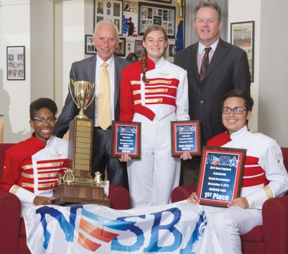 Drum Major Mariama Codrington and Assistant Drum Majors Olivia Blauvelt and Andres Jiminez are pictured with Charles Poole and Eugene O'Brien displaying some of the many awards Everett music groups and bands have won in regional and state competitions.
