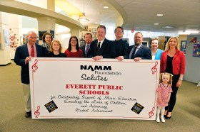 Everett Public Schools music educators celebrate the district's NAMM designation as one of the Best Communities for Music Education. From left: Percussion Director Charley Poole, Brass Specialist/Chamber Ensemble Advisor Cassandra McDonald, Violin Specialist Anna Polska, Choral Director Cheri Spencer of the Keverian School, Music Teacher Nicholas Abruzzese of the Parlin School, EPS Coordinator of Music Eugene F. O'Brien, Orchestra Director Maciej Kaczmarek, Elementary Band Director Eric Holmes, Music Teacher/Cellist Lauren Patriquin-Muise of the English School, Music Teacher/Assistant Orchestra Director Jorunn Kaczmarek of the Lafayette School and string student Aria Kaczmarek.