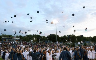 Hat's Off: Caps fly high into the year as the Class of 2018 is graduated.