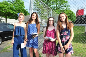 Shown, from left to right, are handing out programs Alivia Burke, Nina Vrankic Victoria DeNovellis, Allison LeBlanc. (First girl is Olivia but with an A)