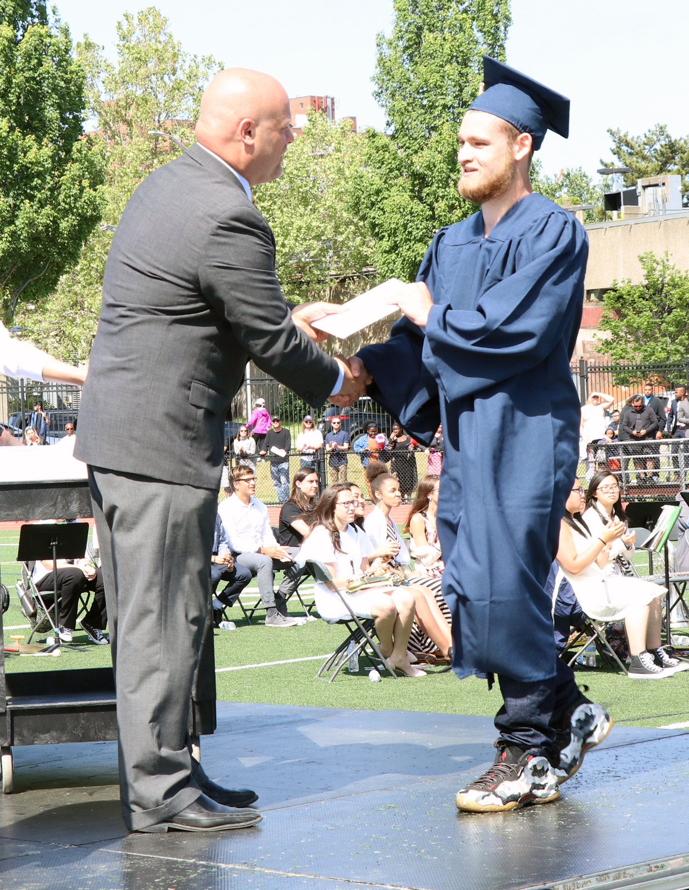 Graduate Michael Giordano receives his diploma from Principal Chris Mastrangelo.