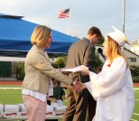 Shauna Braid crosses center stage for her diploma.