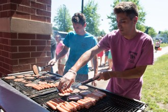 Richie Polignone and John Leone prepared hot dogs and burgers throughout the 4th of July celebration in Revere
