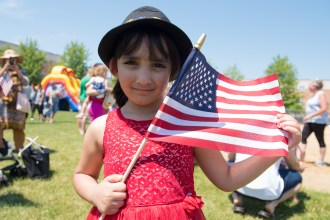 Menaal Khan showed off her new American flag at the SBA field in Revere during the 4th of July festivities on Wednesday