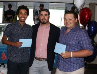 Coach Michael Manning is shown with two of the seniors, Alex Biaz and James O'Donnell (Shawn Goslin not shown). The boys were given scholarships from the Parents Club from funds raised throughout the year.