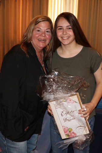 President of the Parents Club Denise Anderson presents a gift to Julie Raffa for being the top raffle ticket seller.