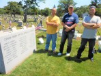 A CEMETERY BRIGADE: Vietnam War veteran Gordon Shepard, center, leads a small work crew that finished off a major part of his latest veterans volunteer project this week at the Riverside Cemetery. Andrew DePatto, left, summertime help at the cemetery; and Tim Fawcett, Jr., far right, helped Shepard replace the marble posts that will hold the name markers that will identify 25 of the 26 Saugus Civil War soldiers buried in the Civil War veterans burial plot in Riverside Cemetery. The final phase of the project expected to be done at year's end will include lettering on the name markers or shields that will go on each post. The 26th person buried in the plot is an unknown Civil War soldier. (Saugus Advocate photos by Mark E. Vogler)