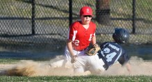 Matt Turgilli of Everett tags out Tyler Taddia of Medford as he slides into third base during their Little League District 12 game 6-2 loss to Medford at Gillis Park in Medford on Thursday, July 12, 2018.