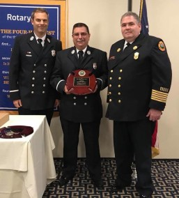 Lt. James Alexander (center) received this year's Fire Officer of the Year Award on June 28 at the Rotary Club Luncheon. He is pictured with last year's recipient, Lt. David Cumming (left), and Fire Chief Mark Tetreault (right). (Courtesy Photos)