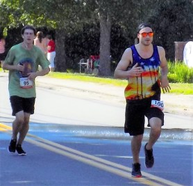Joseph Motzkin, 20, of Lynnfield (left) and Jeffrey Cook, 25, of Brookline, approach the finish line of the the 51st Annual Fourth of July Road Race on Summer Street.